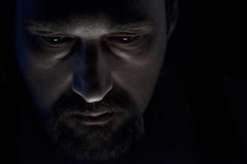 Lonely Bearded Man in Darkness
