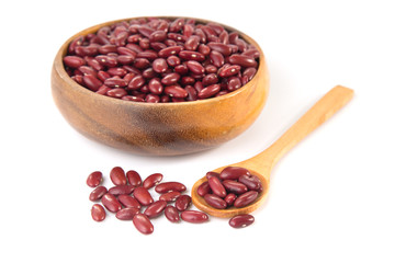Red beans in wooden bowl and spoon isolated on white background.