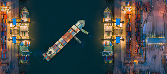 Aerial view container ship from sea port working for delivery containers shipment. Suitable use for transport or import export to global logistics concept.