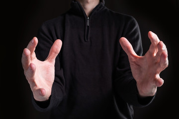 Man holding his hands out and showing something