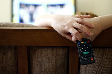 Woman holding a tv remote control