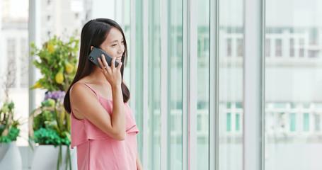 Woman talk to cellphone inside shopping center
