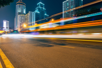 the light trails on the modern building background. Fotomurales