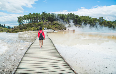 Keuken foto achterwand Oceanië Asian tourist walking on the boardwalk across the Artist's Palette to Champagne pool an iconic tourist attraction of Wai-O-Tapu the geothermal wonderland in Rotorua, New Zealand.