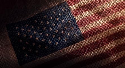 American USA Flag printed on Dark Grunge Burlap Sack , Closeup shot