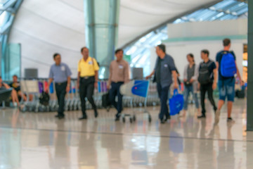 People walking departure from Suvarnabhumi Airport, Thailand blurred for background