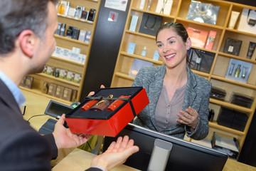 Man buying perfume giftset