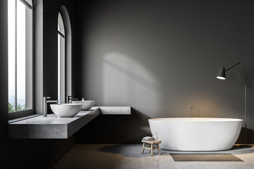 Gray bathroom interior, white tub