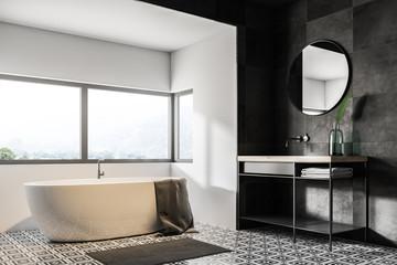 White and black bathroom corner, tub and sink
