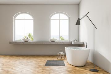 White bathroom interior, white tub, side view