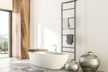 Marble and wooden bathroom corner, white tub