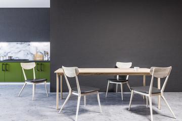 Kitchen interior, green countertops, table