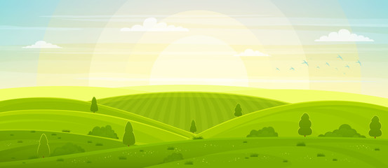 Sunny rural landscape with hills and fields at dawn. Summer green hills, meadows and fields, blue sky with white clouds.