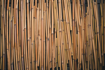 Bamboo brown straw mat as abstract texture background composition, top view above