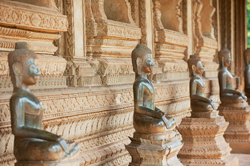Ancient copper Buddha statues located outside of the Hor Phra Keo temple (former temple of the Emerald Buddha) in Vientiane, Laos.