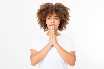 Praying young afro american girl. African woman in summer shirt isolated on white background. Copy space. Mock up. Make a wish