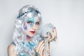 Beautiful mermaid girl in white wig