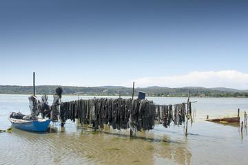 07/15/2018 Thau France. Boats and fish nets on Thau pond in France