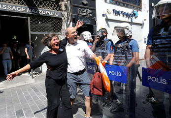 Pro-Kurdish Peoples' Democratic Party (HDP) lawmaker Ahmet Sik reacts as the police prevent Saturday Mothers' 700th gathering in central Istanbul