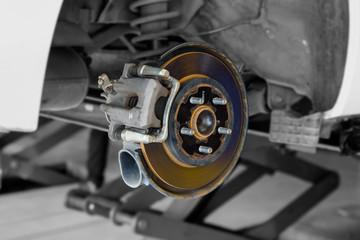 car disc brake part at tyre in garage