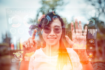 girl using advance technology of computer hologram air screen display mix media business information data chart outdoor