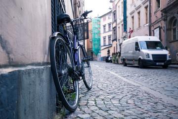Foto op Plexiglas Fiets A bike in the old streets