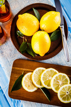 Lemons on cutting board on wooden table