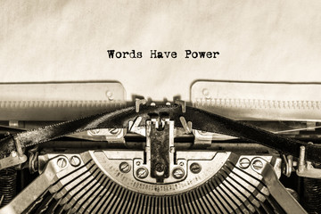 an inscription printed on a vintage typewriter on a piece of paper Words Have Power. writer, journalist. office.