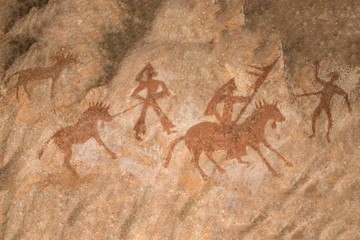 The image of the life of ancient people on the wall of the cave. history, archeology.