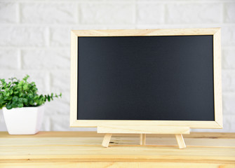 blank blackboard On the wood table In the classic room copy space for your text