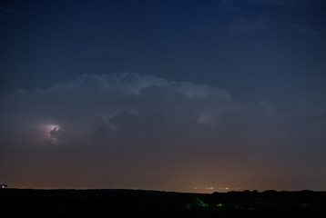 Thunderstorm clouds at night with lightning