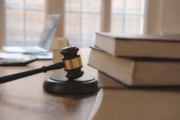 judge gavel & law book at courtroom. lawyer attorney justice workplace