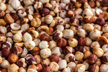 Nut background of hazelnut fruits. Food background. Top view of hazelnut nuts.