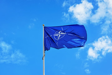 Flag of NATO waving in wind