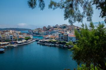 The small lagoon Lake Voulismeni at Greek town Aghios Nikolaos