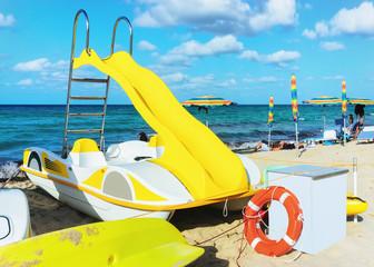 Yellow paddleboat at beach in San Vito lo Capo Sicily