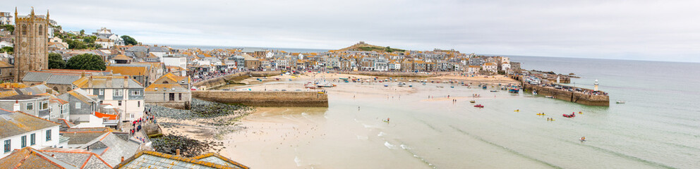 Landscape Panorama of St Ives Harbour at low tide West Cornwall South England UK