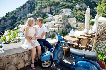 Young smiling tender romantic couple in Positano, Italy
