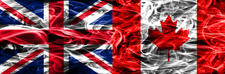United Kingdom vs Canada smoke flags placed side by side. Thick colored silky smoke flags of Great Britain and Canada