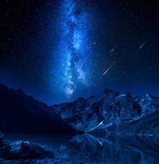 Fototapete - Falling stars, milky way at the lake in Tatras, Poland