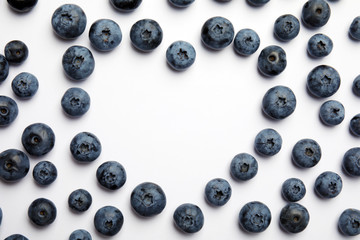 Flat lay composition with tasty blueberry and space for text on white background