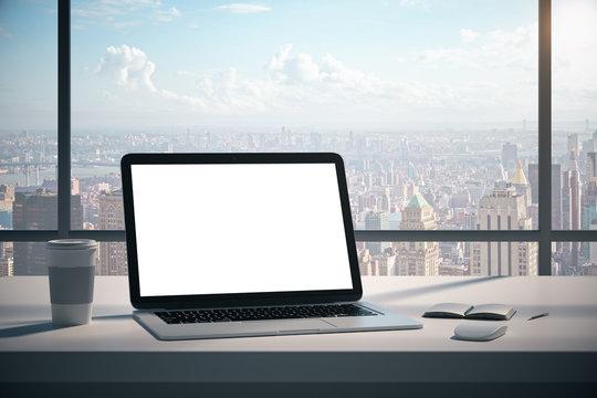 Modern desktop with empty white laptop