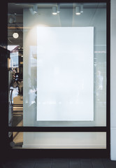 Empty poster behind glass