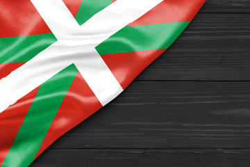 Flag Basques and place for text on a dark wooden background