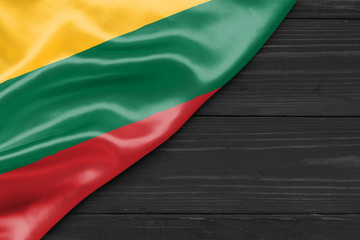 Flag of Lithuania and place for text on a dark wooden background