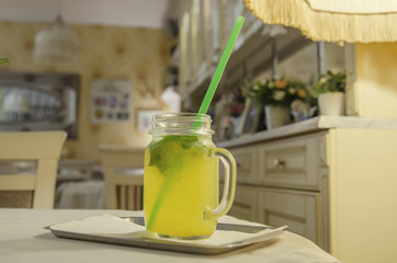 lemonade in a jar with a handle