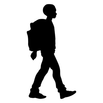Boy goes  with his backpack to school (isolated silhouette)