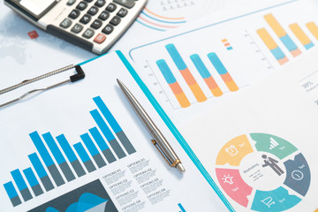 charts. Business reports and pile of documents on gray reflection background