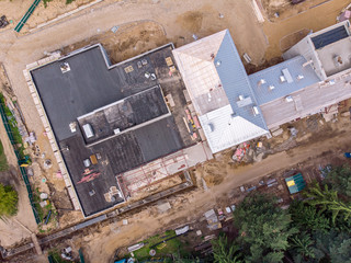 aerial photo of city construction site. metal roof under construction