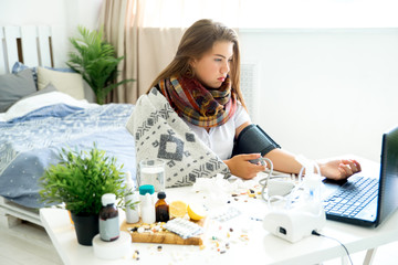 ill young girl with fever spending time at home